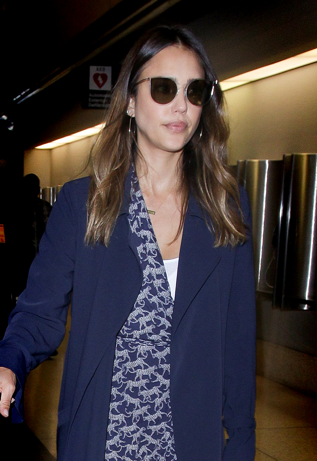 Jessica Alba flying under the radar in LINDBERG sun titanium